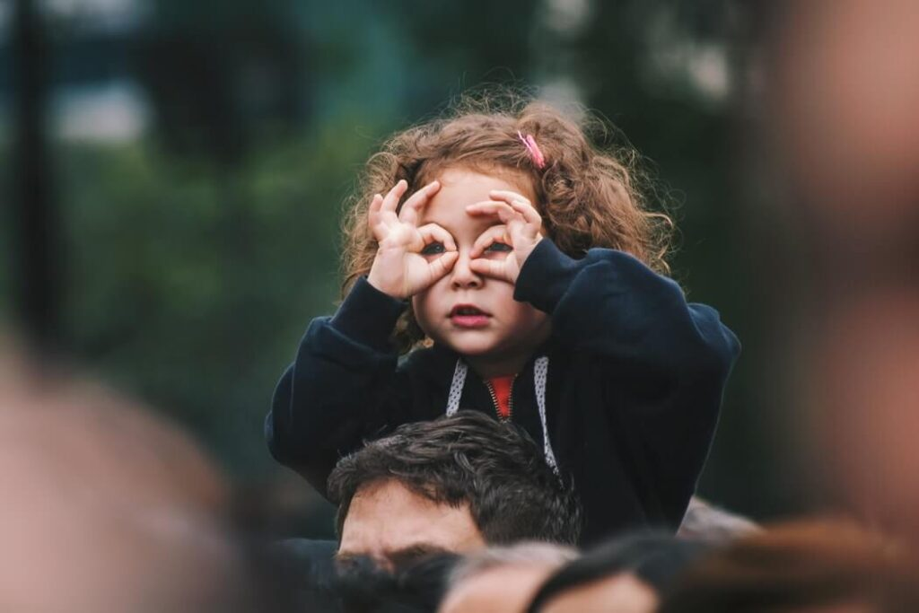 Child holding her hands over her eyes like spectacles